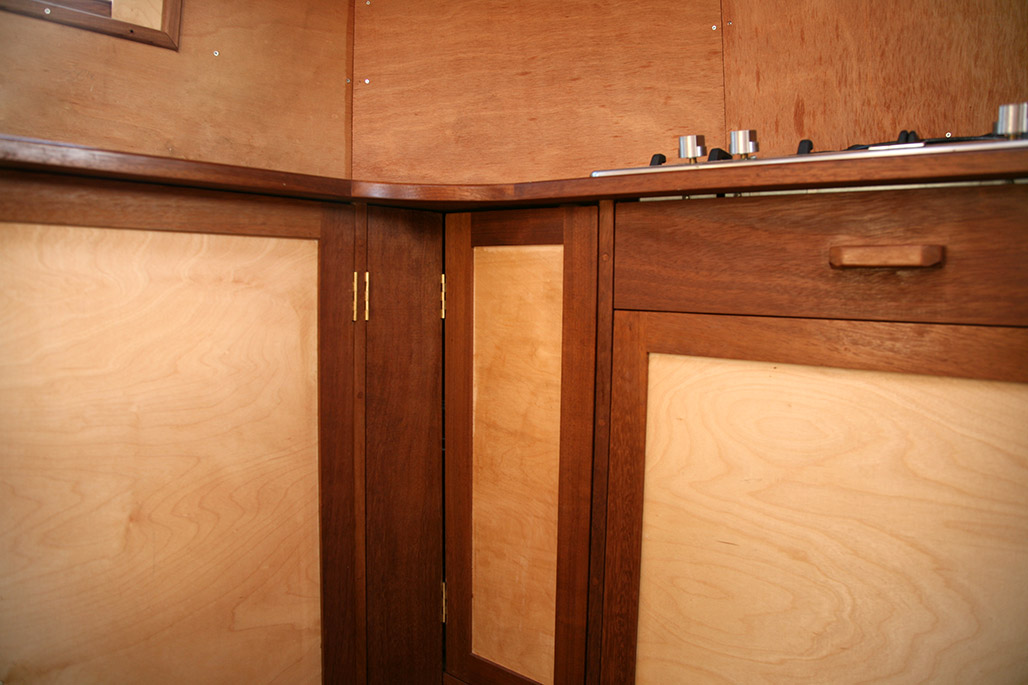 Fitted kitchen on a converted lifeboat.